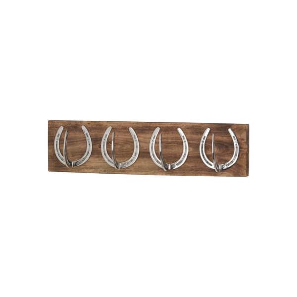 Four Nickel Horse Shoe Hooks On Wooden Board