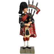Piper  Figurine  In  Royal  Stewart  Tartan