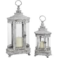 Set of two antique white ornate hurricane lanterns