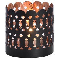 Copper tea light holder with black exterior