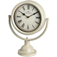 Cream round mantel clock on metal stand