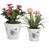 Set of two blue and white floral ceramic planters