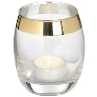 Circular glass tea light holder with brass effect rim.