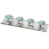 Set of Four Glass Tealight Holders on Mirrored Base